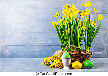Easter holiday card with eggs yellow spring flower narcissus...