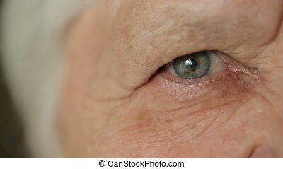 Eye of senior woman - Sad eye of old woman
