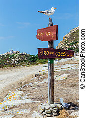 Lighthouse sign on the cies islands - Wooden road signs to...