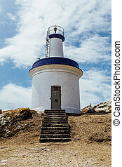 Lighthouse of the cies islands - White and blue lighthouse...
