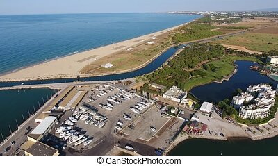 View of the marina in the summer, Vilamoura with air port...