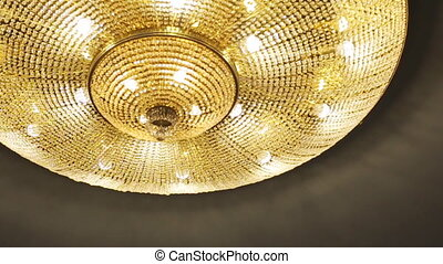 Fancy golden lamp in a famous expensive restaurant