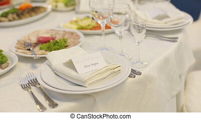 Wedding table full of delicious food and little cards with...