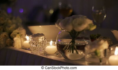 Beautiful wedding decoration on ceremony table, made of...