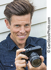Happy Middle Aged Man Photographer Using Camera