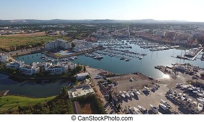 Shooting video bird's-eye view of Vilamoura marina. Portugal