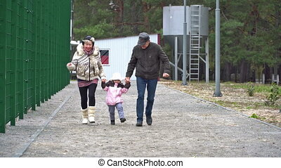 Kid runs to his grandparents - Grandparents running holding...