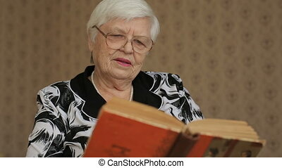 Senior woman reading book - Old woman reading book at home