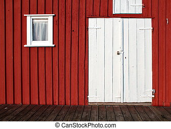 White door on red wall