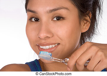 Oral hygiene - Teenager girl brushes her teeth