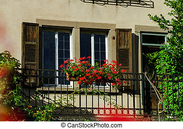 Classic alscien windows with shutters, sunny day