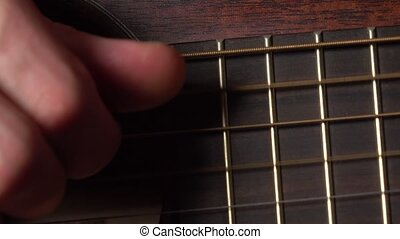 Guitarist hand touching strings. 4K macro video - Guitar...