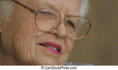 Old woman in a glasses - Old woman reading book at home