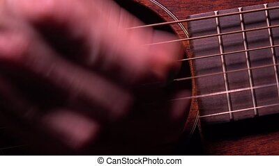 Playing the guitar. Live music performance. 4K macro video -...