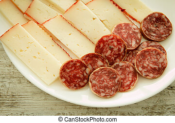 Cheese tray party and sausage. Cold appetizer