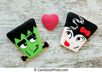 Terrifying couple. Halloween cookies with different shapes