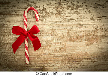 Red candy cane with a beautiful bow