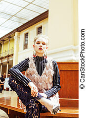 young attractive fashion lady on railway station waiting,...