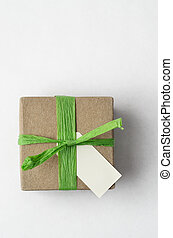 Simple Gift Box with Green Raffia Ribbon from Above -...