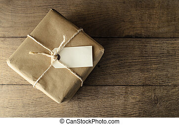 Brown Paper Parcel Tied with String and Blank Label