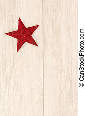 Bright red star on a wooden background