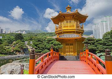 golden teak wood pagoda at Nan Lian Garden in Hong Kong,...