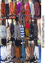 Colorful rosaries on a market