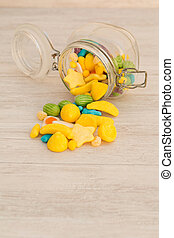 Container glass filled with candies