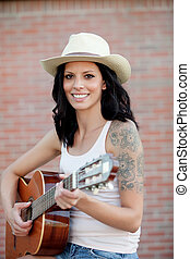 Brunette pretty woman playing a guitar - Brunette pretty...