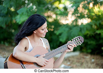 Brunette pretty woman with a guitar - Brunette pretty woman...