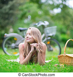 Young girl spending her time in the countryside