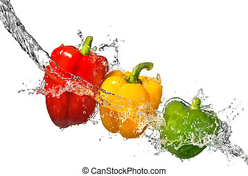 red, yellow and green pepper with water splash isolated on...