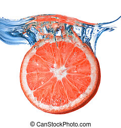 Fresh grapefruit dropped into water with bubbles isolated on...