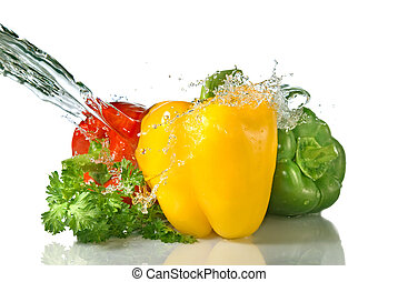red, yellow, green pepper and parsley with water splash...