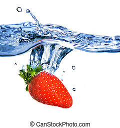 Fresh strawberry dropped into blue water with splash...