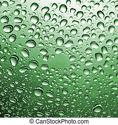 drops of water on green glass