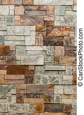 uneven marble blocks wall background - closeup of uneven...