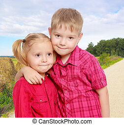 Little boy and girl hugging - The concept of family...