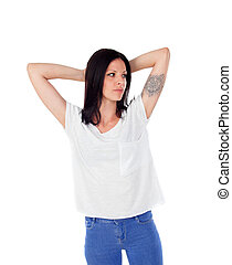 Relaxed brunette woman with a tatto on her arm isolated on a...