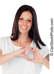 Pretty brunette woman in love making the shape of a heart...