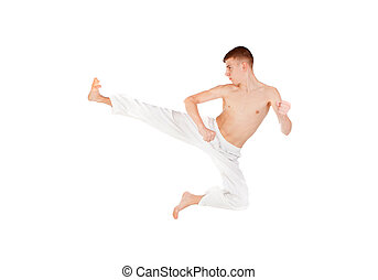 Slim guy practicing martial art isolated on white background