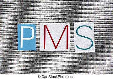 PMS (Premenstrual Syndrome) acronym on grey background