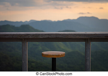 Wooden table with mountain view, Concept of travel and...