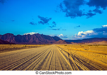 The dirt road in Namib-Naukluft - Travel to Namibia. The...