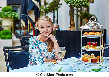Beautiful young woman in French restaurant