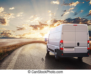 Transport truck. 3D Rendering - Truck on road in a natural...