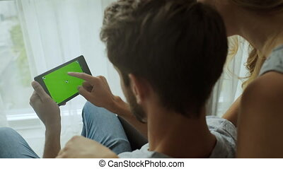 Man and his girlfriend using tablet. green screen Great for...