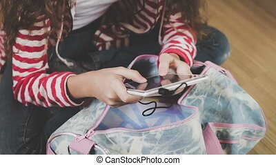 Teen girl on the floor in the room using tablet