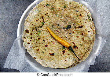 Chapati with chopped spinach leaves