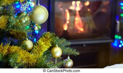 christmas tree in front of fireplace with fire